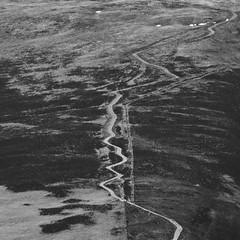 Wiggle (ChrisDale) Tags: road england blackandwhite cloud mountain lake snow landscape mono graphic path district derwent lakes lakedistrict cumbria winding derwentwater keswick cloudscape chrisdale chrismdale