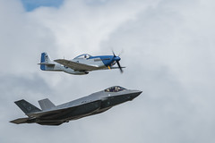 P-51 Mustang and F-35 Lightning historic flypast (tik_tok) Tags: f35 flying lightning aircraft figher jet fast military plane lockheedmartin lightning2 shorttakeoffandverticallanding stovl raf royalairforce demonstration stealth weapon technology p51 mustang historic flypast