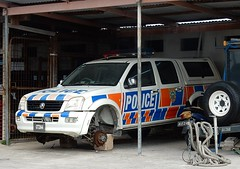 Police With No Wheels (mikecogh) Tags: funafuti tuvalu emergencyservices policecar disabled ironic blocks holden