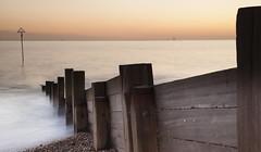 Groynes at Sunset (Seascape snapper) Tags: wood sunset sea water yacht haylingisland slowshutter groynes