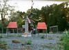 Farewell to Sam's Farms #4 (damiec) Tags: film analog americanflag fallschurch newurbanism redevelopment gardencenter portra400 emptychairs gardenstatuary farmstore pentax645n shiftingsuburbs samsfarms