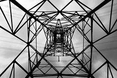 Center of the tower (Dtek1701) Tags: sky blackandwhite bw monochrome up lines metal outside fuji outdoor pov steel wideangle x powerlines electricity fujifilm southerncalifornia ultrawide intersecting apsc xt1 mirrorless xshooter xmount xflens xtranssensor fujinonxf1024f4ois