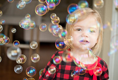 Through the Bubbles (donnierayjones) Tags: morning red baby black girl happy kid toddler child play bubbles pjs bubble jammies pajamas mornin