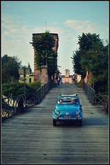 A bridge between past and future (Stefy_P) Tags: auto bridge blue people tower car river boats flickr torre blu fiume barche ponte mantova lombardia fiat500 commessaggio
