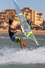 Side view of young windsurfer (Maverick (Dima Fadeev)) Tags: ocean sea summer vacation sky sun man nature wet water sport speed flying athletic cool freestyle surf waves power wind action surfer board horizon extreme surfing surfboard sail windsurfing leisure recreation activity splash windsurfer active windsurf