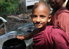 Novice monk (IMG_0570b) (Denish C) Tags: school boy portrait heritage water smile face youth children happy buddha religion sunday young culture monk buddhism bowl wash srilanka ceylon tradition serendipity novice serendip subodharama