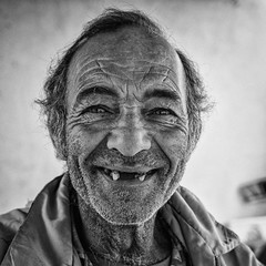 smile- (big andrei) Tags: leica portrait bw man smile village grain cyprus compact dlux nicosia ayiamarina