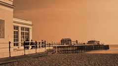 Worthing Pier (Andy Gant) Tags: uk sea england building beach sepia architecture fence buildings sussex pier worthing seaside flickr picture oldbuildings structure textures seashore canoneos beachscene hff bweffect oldandbeautiful canoneos550d
