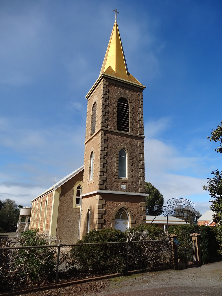 Point Pass. Immanuel Lutheran Church and gold coloured steeple. Built 1876 and the Lutheran Seminary and training college began 1894. It became centre of one of the two main Lutheran synods in Australia.
