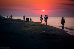 watching the sunrise / © Romulus Anghel (Romulus Anghel) Tags: clouds colors canon costinesti sunrise sun people red capturedmoments beautiful beauty water romania blue earth weather theblacksea seagull