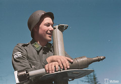 Staff Sergeant Kurt Engman poses with his Panzerschreck, with which he neutralized four Soviet heavy tanks (Jared Enos) Tags: lavolanmaasto finnish finland world war wwii ii panzerschreck soldier infantry history colorized colorization uniform rpg