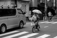 minimal exposure (edwardpalmquist) Tags: shinjuku tokyo japan travel city street urban blackandwhite monochrome fashion road car bike bicycle umbrella parasol sunglasses people woman man outdoors
