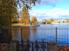 Perfect autumn day at Tampere (KaarinaT) Tags: tammerkoski tampere water fence trees tree lake jrvi bridge fall autumn finland serene peaceful saturday reflection