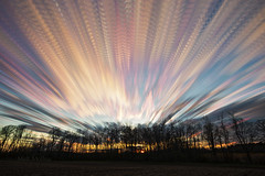 Exhale (Matt Molloy) Tags: mattmolloy timelapse photography timestack photostack movement motion colourful clouds trails lines sky trees branches field bath ontario canada landscape lovelife