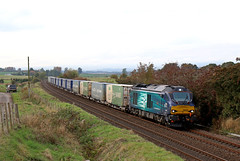 68020 Reliance - Dunning (Andrew Edkins) Tags: 68020 reliance class68 cat stormtrooper dunning supermarket intermodal liner freighttrain scotland perth canon geotagged october railwayphotography drs car winter 2016 photo diesel boxes road asda tesco trees