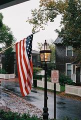 Rainy MV Streets (Nsharp17) Tags: nikon nikonfe film 35mm kodak ektar ektar100 flag americanflag marthasvineyard rain edgartown lantern