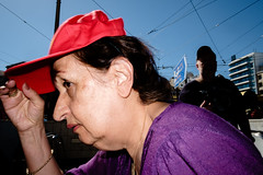 The red cap (Spyros Papaspyropoulos) Tags: colour colourphotography color streetphotography streetphotographer street shadows light athens attiki greece streethunters candid candidphotography fujifilmxt1 xf18 18mm photography lightroom walking dayshot morning day red purple cap woman sky portrait portraiture streetportrait streetportraiture candidportrait candidportraiture flashphotography offcameraflash efx20