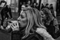 Blond girl drinking IMG_9783-Edit (roger_thelwell) Tags: life street city uk winter portrait england people urban bw white black streets cold london lamp girl monochrome westminster beauty hat rain leather mobile umbrella hair bag walking real photography mono chat shiny phone traffic post natural photos britain circus cigarette candid cab taxi great over sac drinking hats cell photographic smoking lamppost photographs blond oxford conversation shiney talking shoulder handbag stud speak speaking studs commuters scak