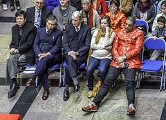 Slouching Dude (The Image Den) Tags: people sitting audience candid chinesenewyear dude vip southampton caught slouch selfimportant dressedfortheoccasion damainman