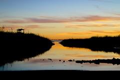 Duck Blind (El Stevo13) Tags: sunset lake reflection oklahoma water glass duck blind hunt overholser