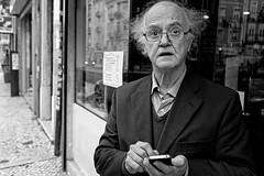 i.lectric (Alvaro A. Novo) Tags: blackandwhite bw man portugal hair glasses phone lisboa lisbon streetphotography surprised iphone arroios