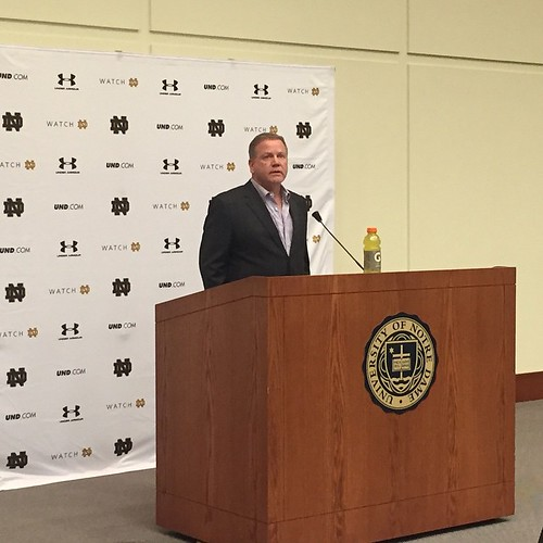 """Irish head coach Brian Kelly pays tribute to Fr. Hesburgh before announcing """"the most committed, cohesive, experienced and probably brightest coaching staff I've put together in my career."""""""