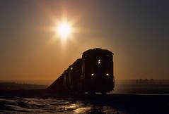 Sunrise over Denver (Moffat Road) Tags: railroad morning sun up silhouette train sunrise colorado co unionpacific locomotive ge leyden coaltrain unittrain cityofdenver ac4400cwcte coalempty