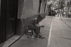 Otro Mundo - Another World (DCullenV) Tags: street door travel people blackandwhite bw espaa woman white david black blancoynegro lines cane night digital geotagged photography photo blackwhite calle spain solitude fuji foto exterior dress nightscape outdoor candid streetphotography photojournalism documentary rangefinder social doorway elderly handheld fujifilm stool basque vasco euskadi vidal caminodesantiago navarra dutchangle cullen theway callejn estella nafarroa lizarra decv x100t