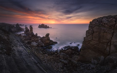 Urros de Liencres (Cantabria, Spain) (Tomasz Raciniewski) Tags: ocean longexposure blue sunset sea cliff seascape beach water rock landscape atardecer mar spain outdoor wide sigma shore 1020 santander cantabria liencres d3200 urros