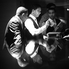 The Baikal Bar Swipe (N A Y E E M) Tags: hassan mahi khoka murshid javed pitchi bartenders manager friend gujarati customer night evening baikalbar hotel radissonblu chittagong bangladesh square cropped indoors availablelight reflection waistlevel