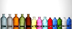 All in a Row (Karen_Chappell) Tags: white bottle bottles glass stilllife multicoloured colourful colours colour color blue orange green brown yellow pink red rainbow spectrum
