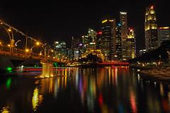 Colourful Reflections (elenaleong) Tags: esplanade singaporeriver artinstallation esplanadebridge skyline longexposure nightscape colorfulreflections elenaleong boattrails