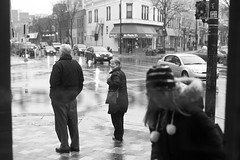 outside (local paparazzi (isthmusportrait.com)) Tags: street winter people blackandwhite bw white black cold silly cars blancoynegro blanco window wet glass smile corner standing bag outdoors happy eos 50mm glasses pod waiting funny downtown raw dof traffic distorted iso400 f14 candid text details negro smiles clarity jacket purse rush flurries usm madisonwi moment serendipity crosswalk joyful snowfall fleeting raining magical f28 ef peoplewatching drizzle spontaneous 2014 sharpness canonraw cr2 isthmus tuttopasta 50mmf14usm danecountywisconsin canon5dmarkii pse7 localpaparazzi redskyrocketman lopaps isthmusportrait photohshopelements7