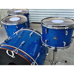 Spent the morning showing off some photos of drums we built recently and stumbled upon this little gem that was never posted. What the hell?! The always classy, Blue Glass Glitter on mahogany shells. 24, 13, 16, 18. #qdrumco #mahogany #drums #rogersfavori