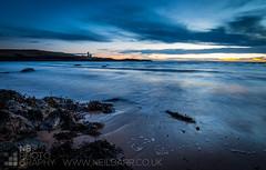 Elie Ness Lighthouse (GenerationX) Tags: blue sea orange lighthouse seaweed yellow clouds evening coast scotland sand rocks waves unitedkingdom fife dusk chess scottish neil pebbles forth ness barr elie earlsferry davidstevenson saintmonans