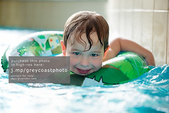 Young boy in inflatable tube swimming (creativemarket.photo) Tags: boy people water pool smile horizontal closeup swimming swim fun happy person kid healthy aqua child little joy device rubber ring swimmingpool health inflatable enjoy laugh bathe recreation activity cheerful spa learn active waterpark flotation