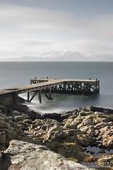 Distant Arran (DMeadows) Tags: sea sky snow water landscape coast scotland pier seaside scenery rocks long exposure waves jetty shoreline scenic goat hills shore coastline fell arran portencross davidmeadows dmeadows davidameadows