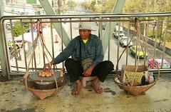 grilled egg vendor (the foreign photographer - ) Tags: plaza bridge canon thailand kiss bangkok egg pedestrian pole vendor grilled shoulder laksi 400d