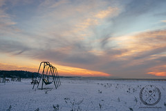 February 22, 2015-JDS_9343-web (Jon Schusteritsch) Tags: park winter sunset sky snow ny cold ice beach beautiful clouds 35mm landscape li frozen suffolk nikon snowy scenic dramatic sigma naturallight longisland swingset lonely iced local february frigid northfork mattituck breakwater eastend winterscape 2015 lisound d610 nofo sigma35mmf14 jschusteritsch northforker jonschusteritsch
