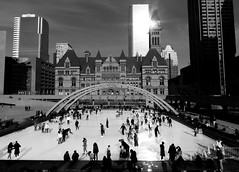 Ice Skating At Nathan Phillips Square .... Toronto, Ontario (Greg's Southern Ontario (catching Up Slowly)) Tags: winter people urban toronto ice monochrome square nikon iceskating persons civicsquare blackandwhitephotography torontocityhall nathanphillipssquare urbanphotography torontoist nikoncoolpixp510