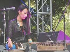 Leather and Tradition (mikecogh) Tags: leather traditional korean jacket instrument strings womad zither womadelaide gayageum kayagum jambinai