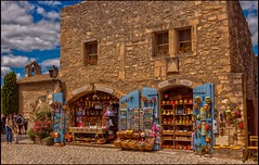 SHOPPING MEMORIES - SOUVENIRS ACHATS . (TOYOGRACOR) Tags: people panorama france canon flickr dof fav50 windmills explore galaxy panoramica arles francia pueblos lanscape provenza nwn costaazul godlovesyou lesbauxdeprovence fav100 bej mywinners abigfave flickrdiamond platinumheartward panoramafotografico mygearandme mygearandmepremium mygearandmebronze mygearandmesilver anpegon carrieresdelumieres pueblosdefrancia