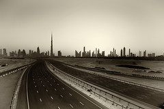 Unfinished City (ecmguy77) Tags: dubai downtown burj khalifa antique plate old yellowed mono road highway empty uae ecmguy robertwork