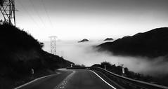 morning_drive [explored 8.14.16] (zzra) Tags: mountain drive road black white bw grain cloud
