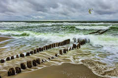 The groynes of Sylt break the surf (jgokoepke) Tags: sylt island germany northsea surf groynes longexposure kitesurfing