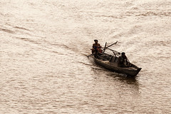 Mekong fishers (Chiara Abbate) Tags: cambodia koh trong chiara abbate chiarabbate mekong river village stilts poverty poor boat fisher hut