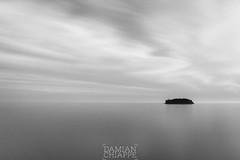 La Isla (Damin Chiappe) Tags: asia coreadelsur jeju isla largaexposicin minimalista paisaje solitaria blancoynegro mar island sea longexposure blackandwhite