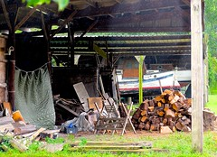 Flood & power cuts? No problemo! (violetchicken977) Tags: houseboat logpile junk street shed