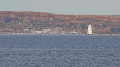 Distant Chequemegon Bay Lighthouse and Harbor (Sam Wagner Photography) Tags: chequemegon bay lake superior ashland lighthouse breakwater day fall autumn washburn marina harbor boats