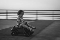 Full speed. (Pablin79) Tags: portrait boy people street light coast car outdoor motion blackandwhite white child monochrome happy fun black kid funny little childhood one baby action argentina vicente misiones vini posadas